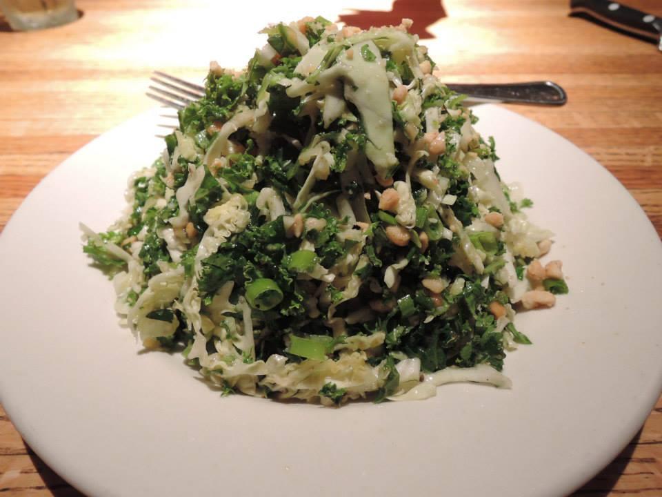 Emerald Kale Salad with roasted peanut vinaigrette dressing.